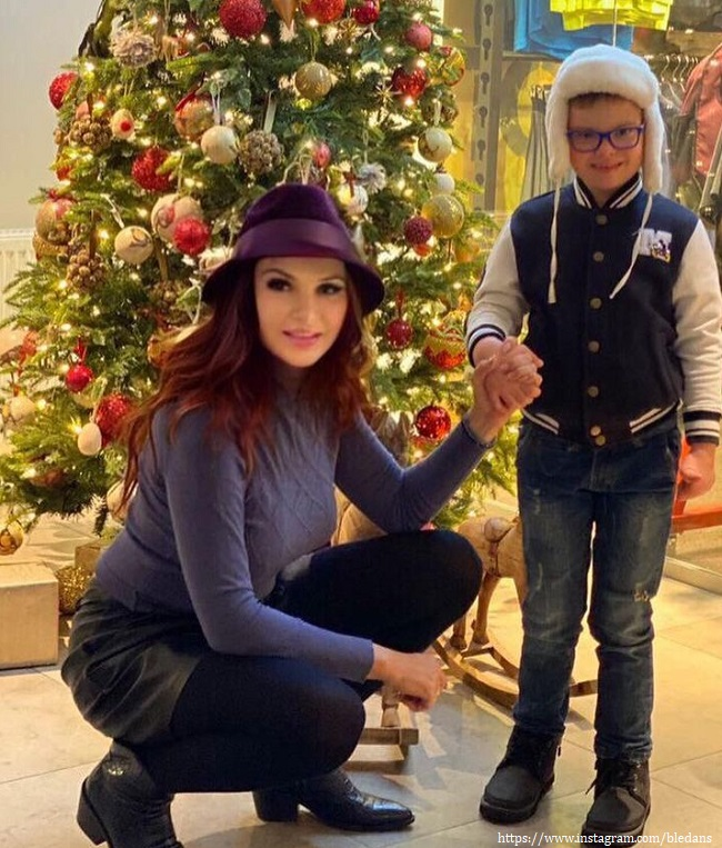 Evelina Bledans decorated the Christmas tree with her son
